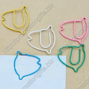 shaped paper clips in the outline of tropic fish