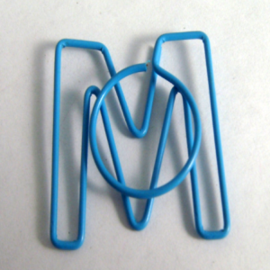 shaped paper clips in the outline of letter M