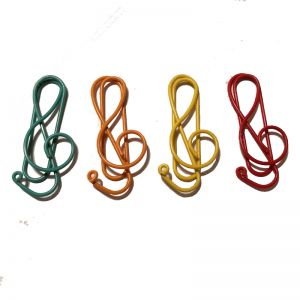 shaped paper clips in the outline of musical note