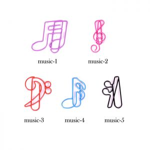 shaped paper clips in the outlines of various music notes