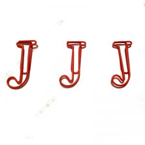 shaped paper clips in the outline of letter J