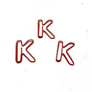 shaped paper clips in the outline of letter K