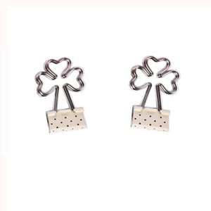 white binder clips with the handle in trefoil shape, silver-handle binder clips